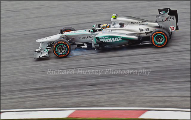 Lewis Hamilton locks his brakes entering the final corner.
