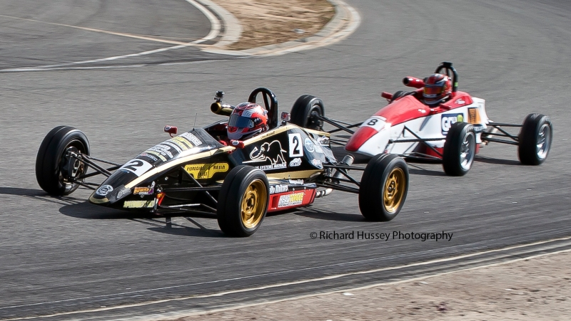Weekend victor Anthony Martin (trailing) and Christopher Mitchel drive nose-to-tail during the day's opening race.