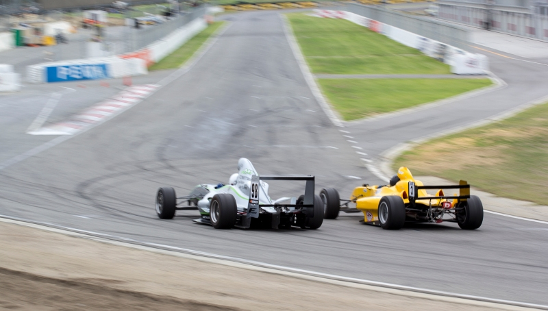 Riley (left) and Burns jostle for position heading into the main straight.